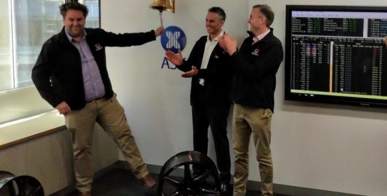 Carbon revolution representatives ringing a bell