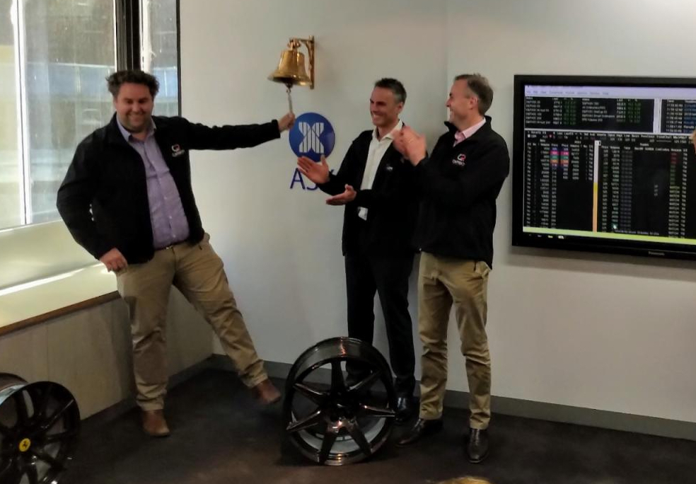 Carbon revolution representatives ringing a bell